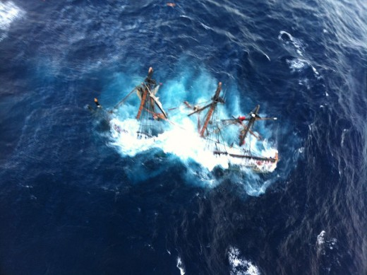 The Bounty foundering, as the USCG rescues crew members.  Image courtesy USCG & Wikimedia Commons.