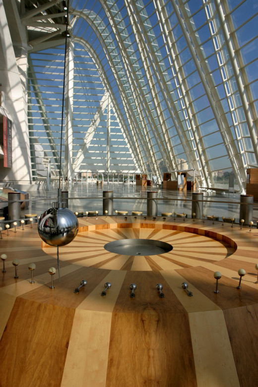 Foucault pendulum.   The Earth's rotation causes the trajectory of the pendulum to change over time, knocking down pins at different positions as time elapses and the Earth rotates