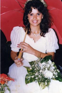 Beautiful newlywed bride under a red umbrella