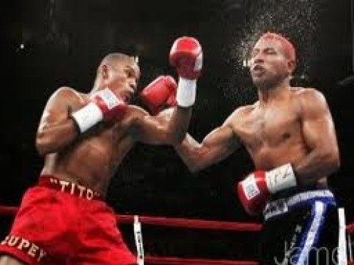 Felix Trinidad Rips Ricardo Mayorga with a left uppercut in a middleweight bout which Tito won by knockout.