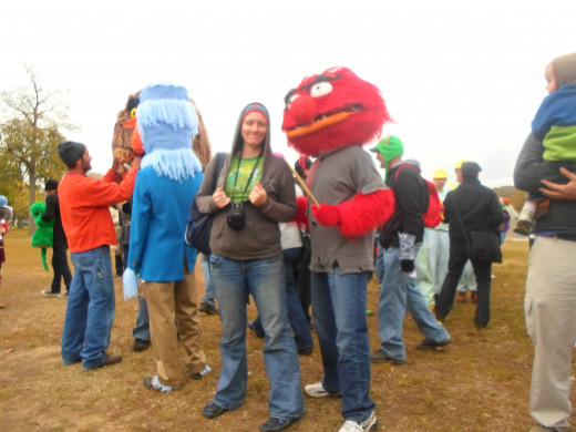 A picture of me and, wearing my Seaseme Street shirt, and Animal character at the rally on the lawn for PBS funding.