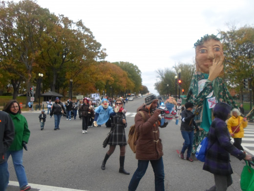 During the march, troward the end, rounding the corner of the Capital building here is the Mother Earth Puppet.