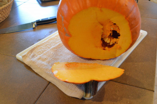 Cut the top off the pumpkin using a sharp knife.