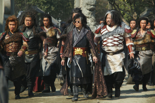 Silver Lion (Byron Mann), in the shades, leads a cast of thousands.  Bronze Lion (Cung Le, three-time world champion martial artist)  is on the far left.