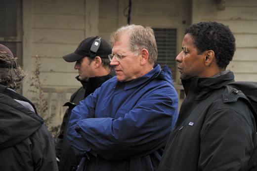 "Director Robert Zemeckis (center) and Denzel Washington (right) on the set of the movie ""Flight"""