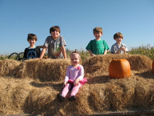Kids love playing on hay.