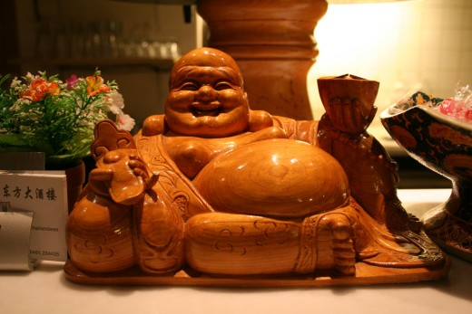 Laughing Buddha statues depict a stout, smiling or laughing bald man in robes with a largely exposed potbelly stomach, which symbolizes happiness, good luck, and plenitude :)