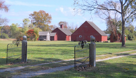 View of the other buildings on the plantation. The large one is the granary.