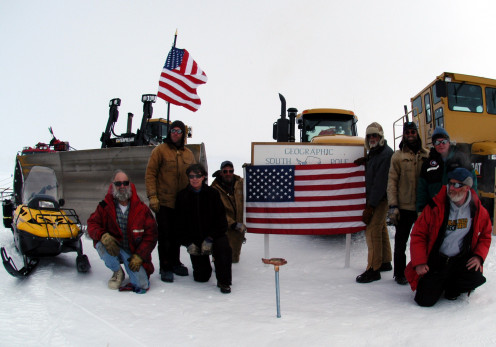 The Antarctic traverse arrived at the South Pole on Dec. 23, 2005. John Wright (holding flag), project manager. Photo, June 1, 2006