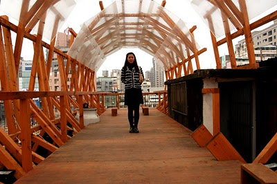 Project Manager Nikita Wu at Wang-Shu's illegal architecture on the roof of the Urban Core Cafe in Taipei next to the Ruin Academy.
