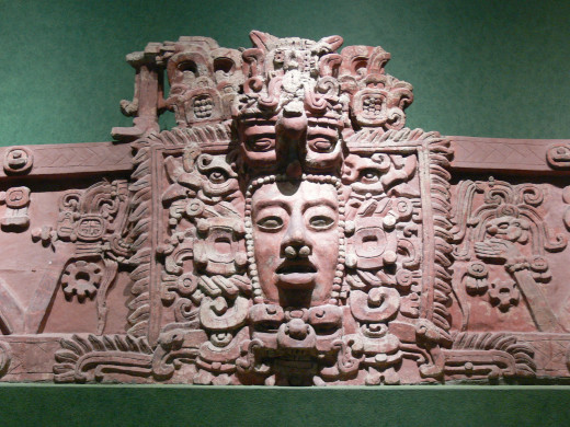 Carving of an ancient Maya mask.