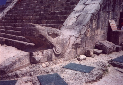 The Feathered Serpent on the side of the pyramid steps of El Castillo.