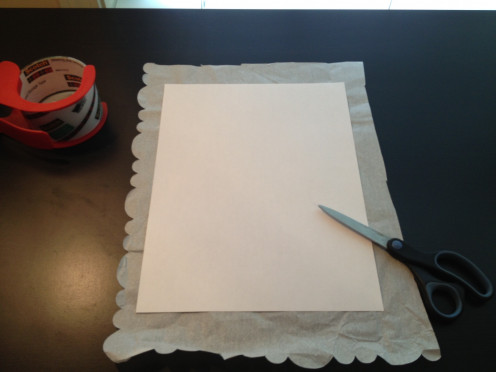 "Trim the tissue paper about 1"" larger than the printer paper to allow an edge to fold over and tape."