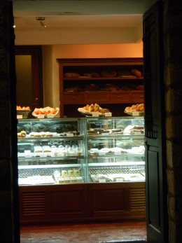 You are greeted with a display of desserts and bread.