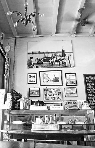 Vintage chandelier and old photographs at Kopitiam