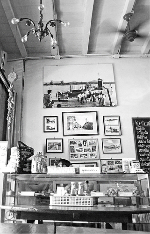 Vintage chandelier and old photographs at Kopitiam