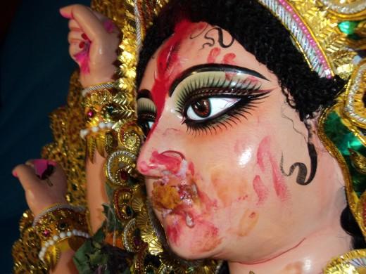 Goddess Durga smeared with Vermilion ( Sindoor)