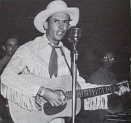Hank Williams in concert in 1951. (Hank_Williams_publicity.jpg: MGM Records)