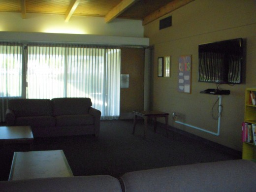 Typical dorm lounge has big-screen tv and comfortable seating