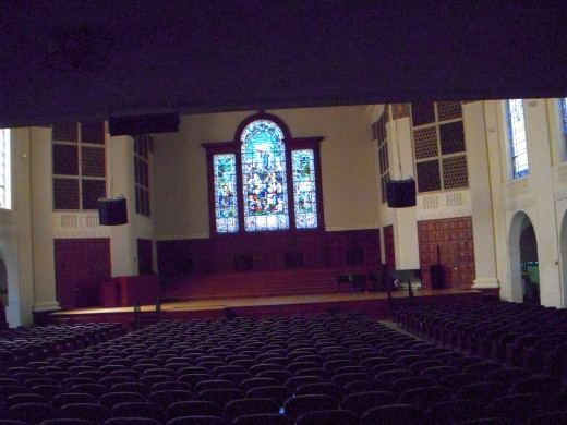 Inside Memorial Chapel. Three paneled window contains 3500 pieces of stained glass.