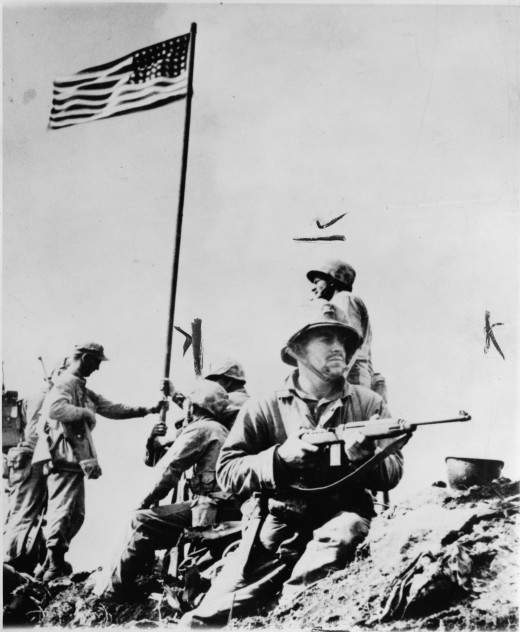 First flag raised over Mt. Suribachi (23 February 1945).