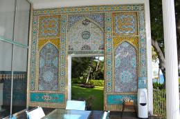 This ceramic tile mosaic on Shangri Laʻs lanai . . . is a just a small taste of the lavish art inside.