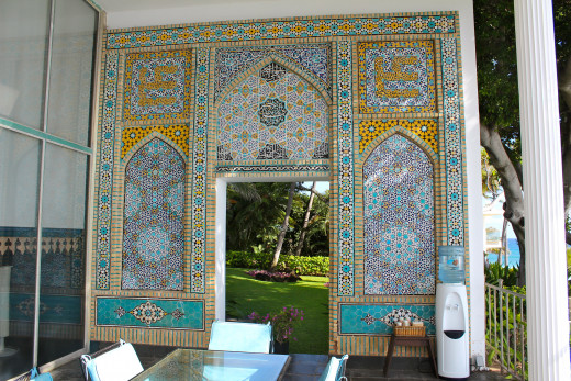 This ceramic tile mosaic on Shangri Laʻs lanai . . . is a just a small taste of the lavish art inside.