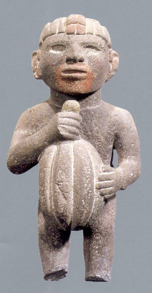 Aztec sculpture of man with cacao pod.