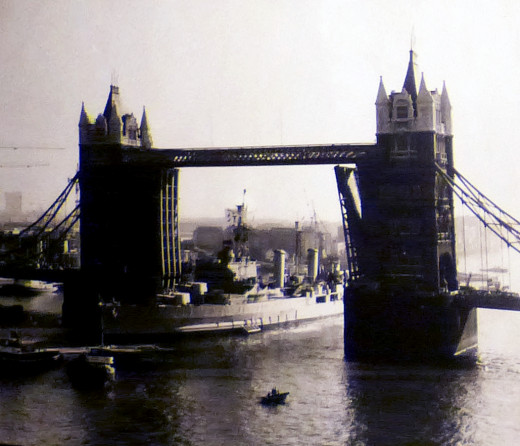 This is the Belfast in 1971 being towed to its moorings on the Thames