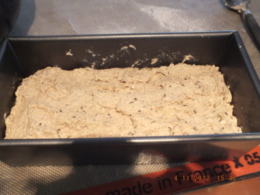 Place dough into the bread loaf pan and pop in the oven.