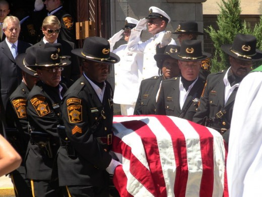 Members of the Milwaukee County Sheriff's Department Honor Guard Escort Deputy Aleman's Coffin.