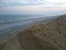 THE SAND BROUGHT UP FROM THE OCEANS EDGE TO REBUILD OUR BEACH AND THE DUNES TO PROTECT US FROM FUTURE STORMS. WE ALL HAVE TO START ALL OVER AGAIN.