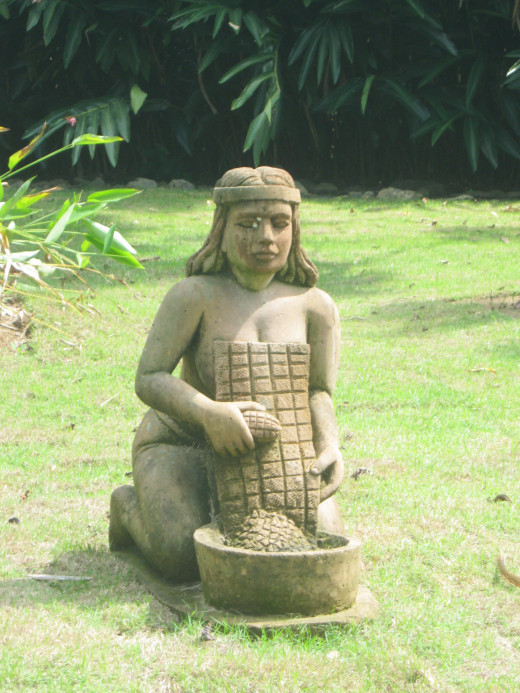Taino woman preparing casabe