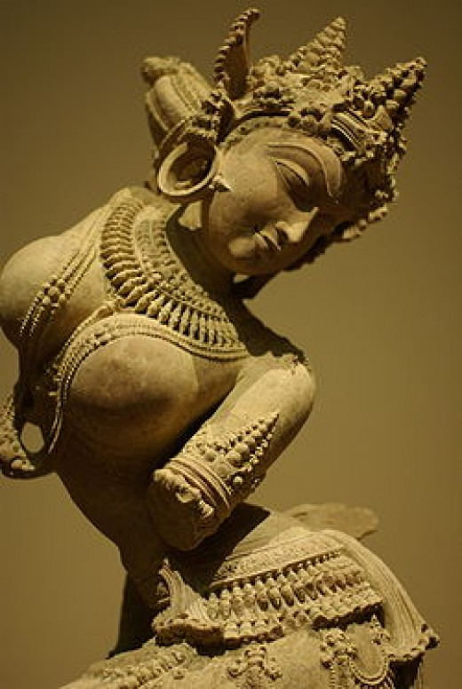 Apsaras are beautiful, supernatural female beings. They are youthful and elegant, and superb in the art of dancing.Apsaras are said to be able to change their shape at will, and rule over the fortunes of gaming and gambling. Urvasi, Menaka, Rambha an
