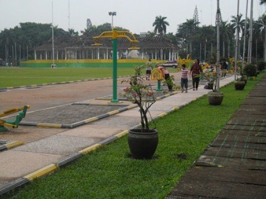 Traditional sports tools. Background: The building where national independence ceremony takes place every year.