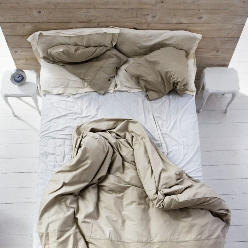 An unmade bed may denote unfinished business in the bedroom.