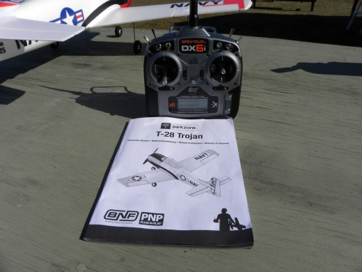 A transmitter is needed to fly RC planes.  Many models are available.  Mike's transmitter is a Spektrum DX 6i