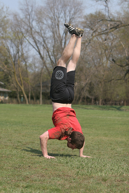 Man doing handstand push-ups.