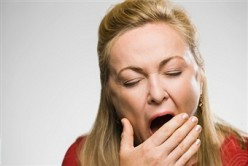 LAZINESS TIP OFF: THE HAND-OVER-THE-MOUTH YAWN.