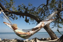 THIS MAN IS IN AN ENVIABLE PLACE: BEING LAZY IN A HAMMOCK.