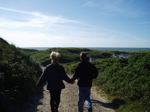 A couple holding hands on a walk