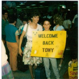 Greeting Tony at the airport on his return trip.