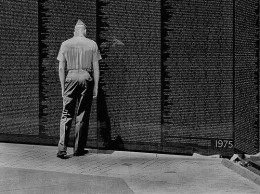 A moment of reflection at the Vietnam Memorial