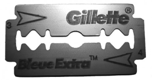 A double edged razor blade is the best tool to use to remove dried in paint or woodstain from a glass surface.