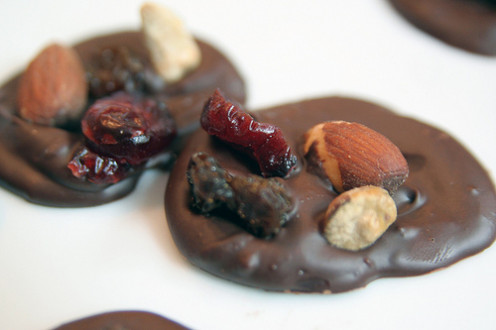 Chocolate candies topped with pistachios, raisins, almonds, and orange. Click for the recipe.