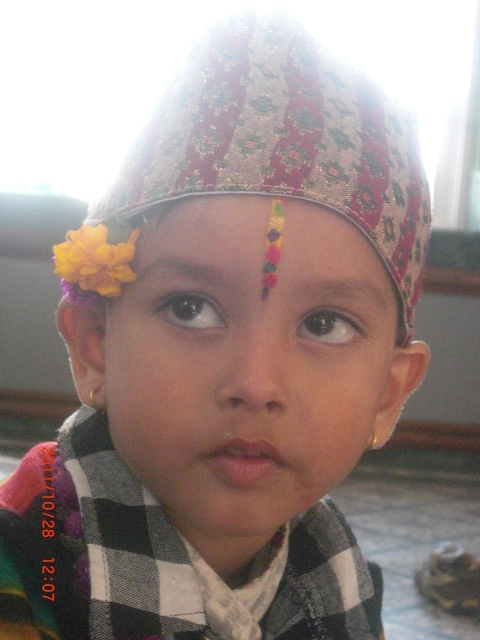 A Nepali Boy With Tilak On His Forehead