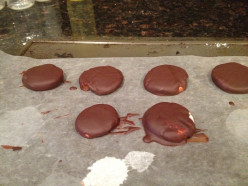 Dip the peppermint patties into the chocolate and place on waxed paper to cool.