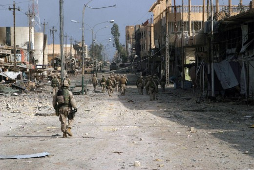 Fallujah, Iraq (Nov. 15, 2004) - Iraqi Special Forces Soldiers assigned to the U.S. Marines of 2nd Squad, 3rd Platoon, L Company, 3rd Battalion, 5th Marine Regiment, 1st Marine Division, patrol south clearing every house on their way through Fallujah