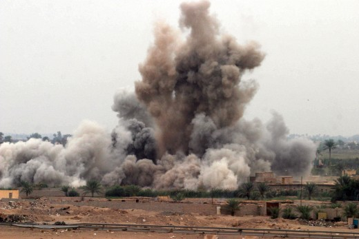 Fallujah, Iraq (Nov. 8, 2004) - An air strike is called in on a suspected insurgent hideout at the edge of Fallujah, Iraq by U.S. Marines assigned K Company, 3rd Battalion, 5th Marine Regiment, 1st Marine Division, during the opening hours of Operati