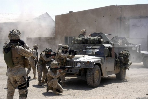 U.S. Marines with Company A, 1st Battalion, 5th Marine Regiment, fire against terrorists operating in Fallujah, Iraq April 7, 2004. U.S. Marines suspended offensive operations after isolating and systematically clearing portions of the city.